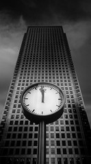 Nearly Noon (Semi-detached) Tags: shadow white money black london tower clock businessman work dark nikon time centre united kingdom business wharf noon canary 12 financial hsbc finance nearly semidetached d300