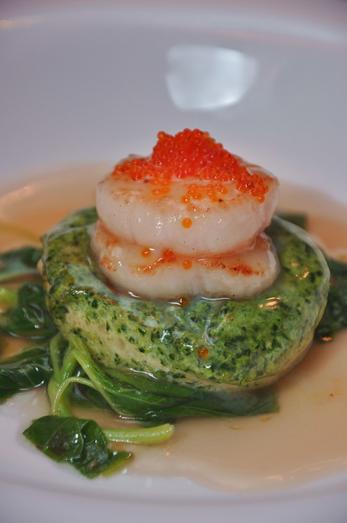 Braised homemade emerald bean curd with seasonal greens topped with pan fried fresh scallop
