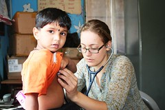 Petra, foreign doctor volunteering with health check-ups.