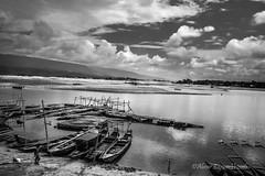 The Leisure (Abrar Zaman Ayon) Tags: boat river bangladesh sylhet countryside travel blackwhite holiday clouds sky landscape horizon global nikon photography photographer