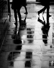** (donvucl) Tags: london rain reflections figures street pavement bw blackandwhite olympusem1 donvucl