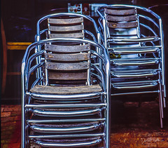 Stacked chairs, chrome and wood (danielnotnow1) Tags: leica leicafilm leicaanalog leicam3 leicam4 summicron50mmv4 fujivelvia50 slidefilm color colour film filmphoto filmphotography 35mm 35mmfilm 35mmfilmphoto analog analogue vintagecamera vintagelens sunny16 colors explore colorsinourworld colorfullaward