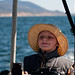 Kenny Erickson, age 10, piloting the Dos Osos 34' boat outside Morro Bay, CA 28 July 2010 (in set of 6)