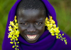 Surma smiling kid with flowers - Turgit Ethiopia (Eric Lafforgue) Tags: flowers boy smile kid artistic culture tribal ornament tribes omovalley bodypainting tradition tribe ethnic rite surma tribo adornment pigments ethnology tribu omo eastafrica thiopien suri etiopia 3600 ethiopie etiopa  etiopija ethnie ethiopi  etiopien etipia  etiyopya  nomadicpeople      tulgit    peoplesoftheomovalley
