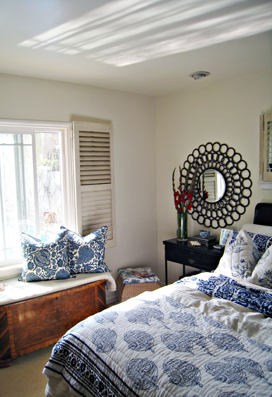 blue and white bedding+barclay butera pillows+antique cedar chest+reflection on ceiling