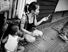 free cigarette (Adrian in Bangkok) Tags: thailand asia bangkok whores prostitutes hookers hookerrow