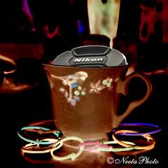 Photography Stays Positive (neetaphoto) Tags: cup nikon negative positive amit d300 amitabha neetaphoto selectivecoloring lenscap colorfulbookbinderrings whyphotography