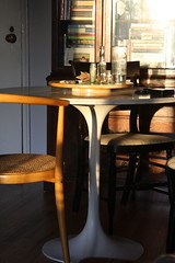 table morning light (GoodAfternoonan) Tags: apartment diningroom tulip therapy midcentury tuliptable apartmenttherapy antiquebottles apartmenttherapyny