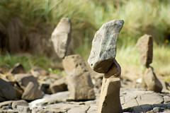 Stone Balancing (On the mountain at dawn) Tags: summer beach rock stone easter island amazing bokeh zen heads balancing
