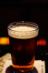 246/365: A Traveler's Brew (AttitudeAJM) Tags: ny newyork beer glass closeup bar nikon drink nikond50 alcohol foam pint samadams lager project365 anthonyjmerced