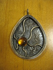 Abstract ammonite with amber