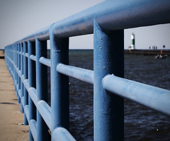 Blue Railing (todd in kzoo) Tags: blue lighthouse water pier dof rail lakemichigan leading southhaven ~~fencefriday~~