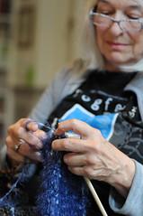 Yvonne knitting (SooozhyQ) Tags: blue woman women dof hand bokeh ring depthoffield yarn dslr eyeglasses needles 50mmf14 artsandcrafts nikond300s fotofeedbackloop
