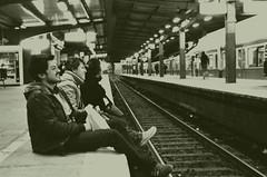 Esperando el ultimo tren (David A Córdova M) Tags: trip travel people berlin film sepia 35mm germany tren photography photo foto shot picture suburbs fotografia amateur bwfilm trenstation 100tx davidcordova deividcordova