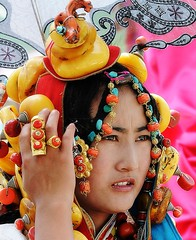 khampa tibetan girl with vast wonderful treasures (BetterWorld2010) Tags: tibetans coral festival gold amber necklace beads costume treasure dress jewelry tibet ring celebration bracelet amdo kham sichuan traditionalcostume 2009 litang headdress robes yushu 服饰 tibetanwoman 玉树 理塘 藏族 khampa golok lithang tibetangirl tribalcostume tibetanfestival 康巴 tibetanwomen