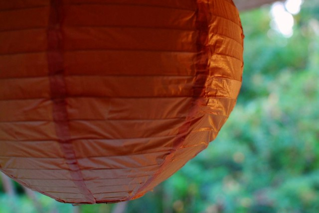 coral paper lantern on the porch