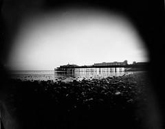 Hastings Pier (mr ig) Tags: beach pier tide low pebbles pinholecamera hastings eastsussex hastingspier qualitystreettin ikg:filename=20100902pinbwex0011ejpg