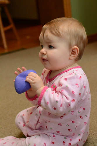 Ella holding football - Nikon D3100 - ISO 3200 - flash