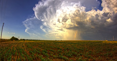 field storm (davedehetre) Tags: sunset summer cloud sun storm field rain weather canon landscape rainbow ks sunny fisheye kansas thunderstorm 8mm hdr chaser prooptic t1i