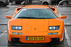 Diablo VT 6.0 (Thomas van Rooij) Tags: lighting street city light orange hot color beautiful dutch face lines car contrast logo concrete photography design amazing cool eyes italian rotterdam nikon power angle lotus thomas expression milano awesome engine style automotive front event exotic devil beast headlight stunner diablo nikkor frontal audi limited executive lamborghini luxury coupe supercar vt lambourghini ahoy sportscar diavolo oranje 2010 combo v12 lamborghinidiablo lamborgini 18105 60l facelift lightweight extasy d90 hypercar rooij diablovt60 maartenmemorial lamborghi