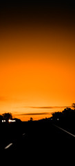 a new day (paulh192) Tags: orange silhouette sunrise nikon highway driving michigan warmth headlights newday
