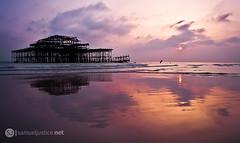 Sundown on the Skeleton (samueljustice.net) Tags: sunset sea orange sun west beach pier justice sand nikon brighton sundown westpier burnt 1855mm samuel brightonpier d90 burntpier