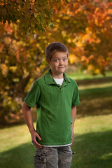 Brent's Autumn Photo (Carl's Photography) Tags: autumn boy orange tree green fall minnesota kids iso100 nikon nef dof bokeh outdoor tripod brent processing mn f28 lightroom selectivefocus individuals sb800 85mmf14d adobelightroom d80 nikkor85mmf14d strobist 1500sec nikond80 sb900 umbrellashootthrough rawnef 1500secatf28 43inchshootthroughumbrella