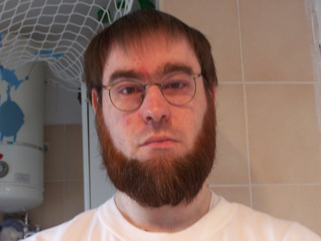 Before: old haircut, old glasses