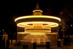 Carousel (Curtis Gregory Perry) Tags: copenhagen denmark tivoli gardens amusement park ride night light motion lines blur carousel spin spinning merrygoround kbenhavn danmark nikon d300   nos m   nacht oche nat   nakts  gauean noite noche       nuit  natt  ntt nag noc no gece noapte notte malam