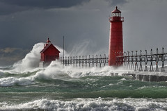 """Nature's Fury""  Grand Haven Michigan Lighthouse,  Lake Michigan   ""Front page Explore # 3 Oct 28, 2010"" (Michigan Nut) Tags: park red sky usa lighthouse seascape storm green art beach nature water clouds landscape geotagged photography pier photo waves wind michigan spray lakemichigan explore recent michiganstate grandhavenmichigan michiganstatepark johnmccormick grandhavenlighthouse frontpageexplore grandhavenstatepark stormforcewinds michigannut jmphotographycasairnet"