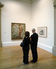 Couple Looking at Lucian Freud's Standing by the Rags at Tate Britain