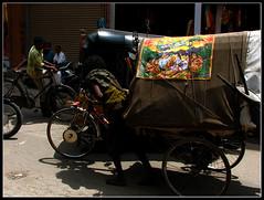 Mendicant at Charminar (Midhun Manmadhan) Tags: india tricycle streetphotography cart hyderabad mendicant carminar