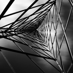 Diamonds In The Sky (Andy Brown (mrbuk1)) Tags: longexposure light shadow sky abstract tower lines metal clouds contrast square mono blackwhite triangle patterns perspective angles frame girders transmitter diagonals mesmerise whereslucy