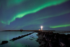 Northern Lights over lighthouse. (Arnar Bergur) Tags: sea lighthouse island lights iceland aurora astronomy northern reykjavk sland sjr borealis phenomenon canon24mm14l