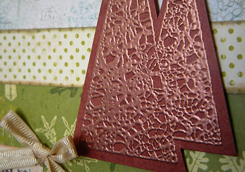 closeup - copper embossing powder on brown