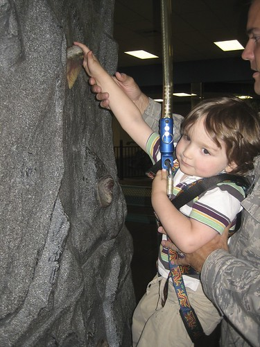 the base has a rock climbing wall!  And Dylan loves it!