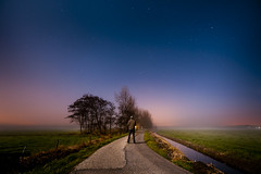 Under the stars (andy.wolf) Tags: road trees sky field fog night stars nightscape farm human tiny stargazing lightpolution uwa urbanlights d700 egmondaandenhoef 1424mmf28g