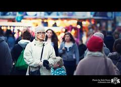 Unknown Woman (Rick Nunn) Tags: christmas street city portrait woman hat glasses day dof market bokeh candid coat sheffield centre gloves canonef135mmf2l vsortpop