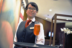 Your juice... (Roving I) Tags: tourism hongkong juice aviation flight service waitresses airports airlines hospitality virginatlantic lounges