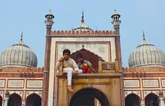 At the mosque (Iatrask {{...Photographo ergo sum...}}) Tags: sky india playing boys children delhi indian muslim islam faith pray praying bluesky mosque chilling curious domes ramadan masjid hindi newdelhi islamic jamamasjid olddelhi indianchildren canoneos550d sip2010