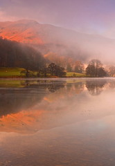 Misty Dawn over Grasmere (Explored) (Steve Thompson images) Tags: trees mist lake mountains reflection water landscape dawn grasmere lakedistrict cumbria opposti