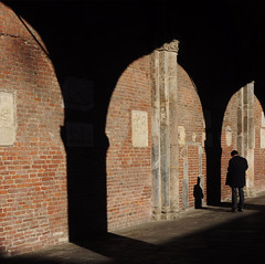 """know yourself"" (pannaphotos) Tags: shadow sun man milan columns arches philosophy porch socrates saariysqualitypictures pannaphotos entranceportico santambrogiochurch"