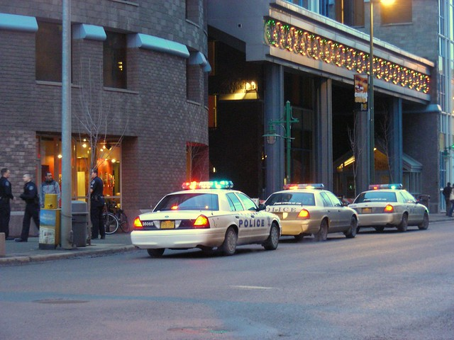 APD officer and cars at the Performing Arts Center, downtown Anchorage