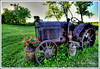 Iron-wheeled Wonder (Tom Mortenson) Tags: tractor antique rusty digital canon summer farm farmtractor canoneos canon6d outdoor farmfield wisconsin usa america northamerica midwest centralwisconsin marathoncounty marathoncountywisconsin mccormick mccormicktractor antiquetractor rural country hdr tonemapping photomatix geotagged milkcans petunias pastoral scenery scenic farmimplement ironwheels 1740l agriculture