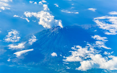 Flying past a volcano (Merrillie) Tags: crater landscape asia nature flying aerial volcano clouds air blue flight plane vacations scenic sky outdoors birdview mountain travel volcanic white
