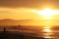 early morning fisherman - matsushima (xthylacine) Tags: ocean morning travel sea sun mountain color colour beach water yellow japan sunrise canon japanese early fisherman waves peace pacific bright asahi wave nippon callaway matsushima japon yama 30d hcallaway xthylacine