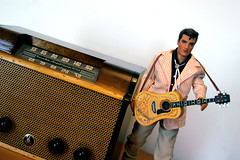 1946 Emerson 512 AM Radio & Elvis Doll on a Slant (Whiskeygonebad) Tags: wood celebrity broadcast radio emerson wire doll pointer cabinet guitar elvis blues dial rr jacket rockroll grille capacitor knobs signal antenna bolotie handsom solder 512 varnish recap rectifier elvispresely 12sa7 12sq7 35z5 allamericanfive 6ss7 schamatic 50l6gt pentagridpartsrepairwoodcabinetchassissoundlistenconverter