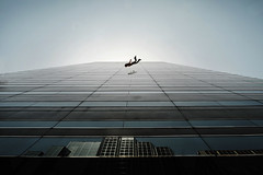 Jumper (.Bradi.) Tags: city blue windows sky urban motion reflection building silhouette architecture person jump falling midair oklahomatower