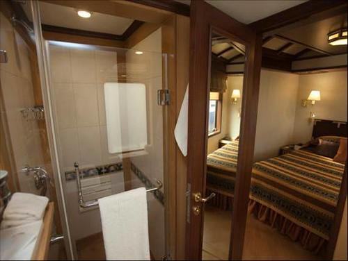 Indian Luxury Train - bedroom with bathroom