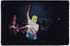 party (Claire Marie Vogel) Tags: show california boy wild portrait people music fish color guy eye film marie tattoo 35mm fun photography fan photo dance claire kid crazy lomo lomography neon mask arm guitar ryan border mosh band picture fisheye miller photograph portraiture mm navajo 35 vogel raised sloppy okie dokie